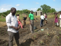 00360-Teaching_orphans_to_tend_Rubatano_gardens.jpg